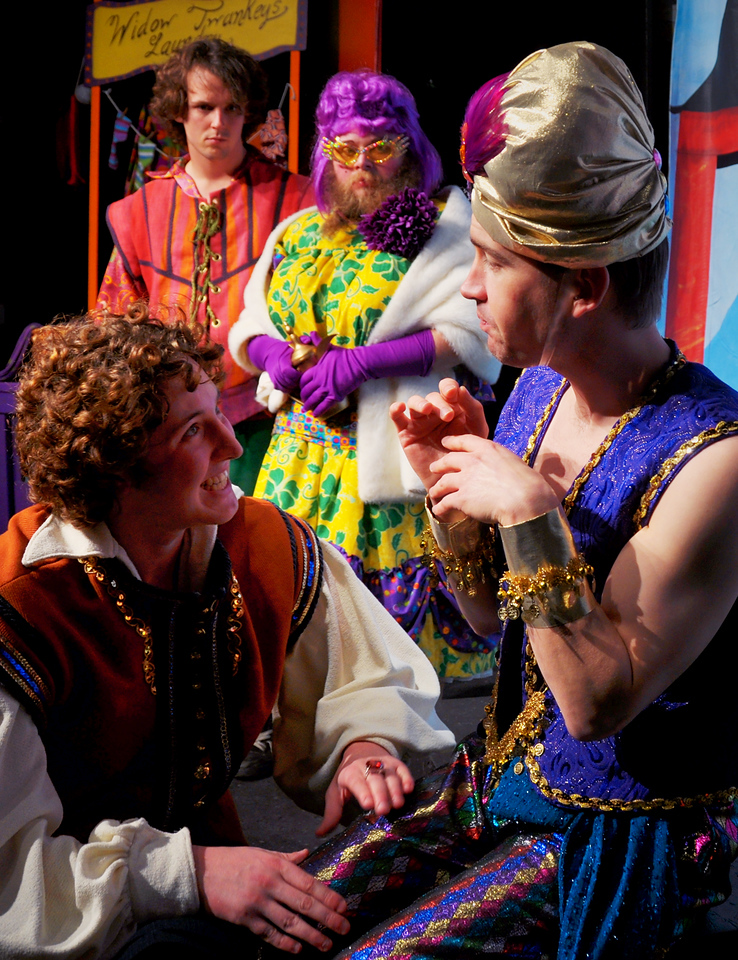 Aladdin tries to convince the Genie of the Ring to help while Wishy Washy and Widow Twanky look on.<br /> L to R: Spencer Padfield, Adam Cyr, Jonathan Dietrich, Rob Card