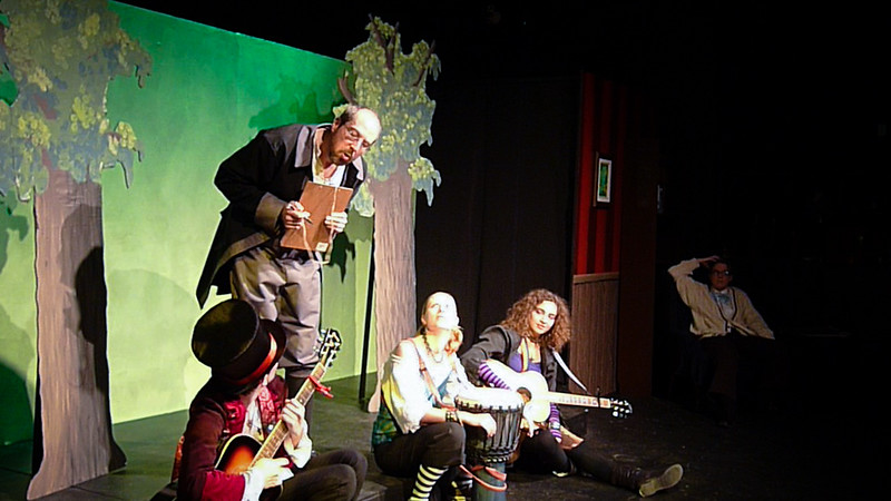 The assistant, trying to contact Cindy about the rescheduling, encounters her band.<br /> <br /> Standing: Sean M Puckett.  Seated: James R Noble, Snow Conrad, Carly Derdarian, Jill Skene.