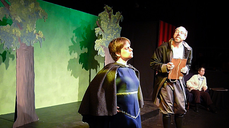 Meanwhile, back in the enchanted forest, a very frustrated assistant learns that the open mic night must be rescheduled so Mr. Prince can rescue those in need.<br /> <br /> Carrie McNabb, Sean M Puckett, Jill Skene.