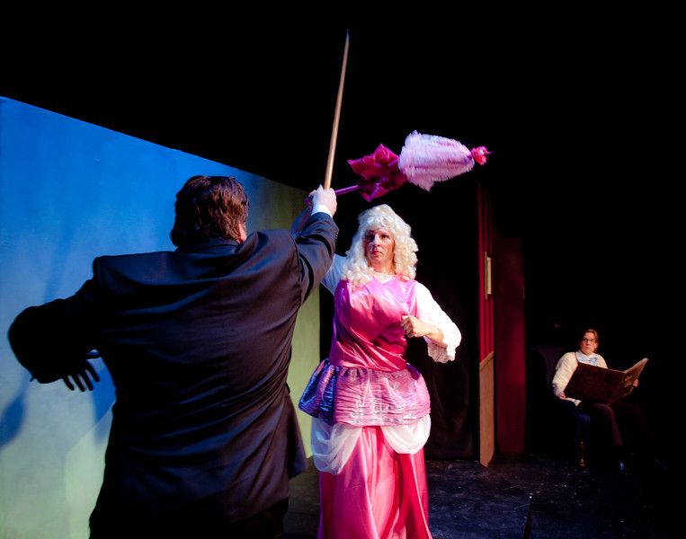 The Fairy Godfather and Fairy God Mother exchange heated blows while the Narrator looks on nervously.<br /> <br /> Matthew Wiebe, Karl Zaryski, Jill Skene.