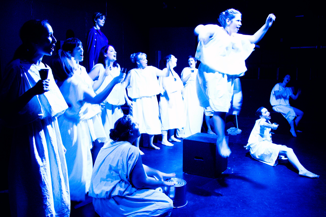 Maids singing of the exploits of Odysseus.
