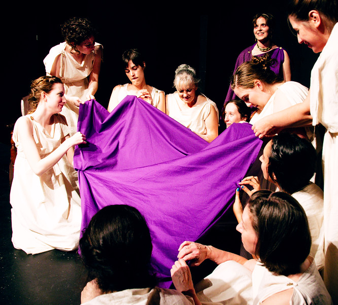 At night, Penelope and the maids work together to unravel the previous day's work on Odysseus' burial shroud.