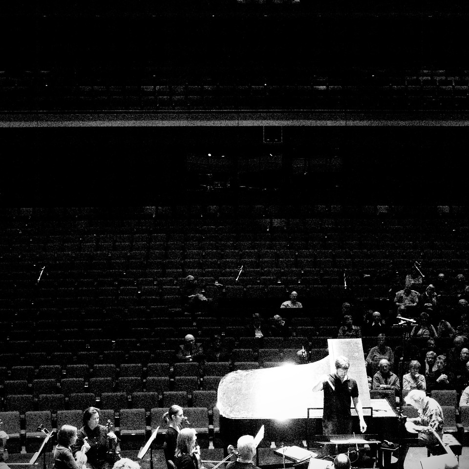 The Kitchener-Waterloo Symphony conducted by Music Director Edwin Outwater during an open dress rehearsal at the Centre in the Square. Guest soloist Anton Kuerti at the piano.  Creative B&W.