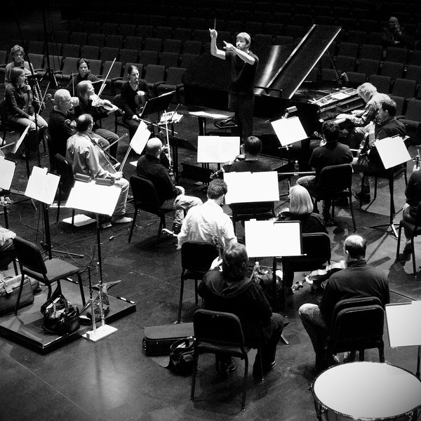 The Kitchener-Waterloo Symphony conducted by Music Director Edwin Outwater during an open dress rehearsal at the Centre in the Square. Guest soloist Anton Kuerti at the piano.  B&W crane shot.