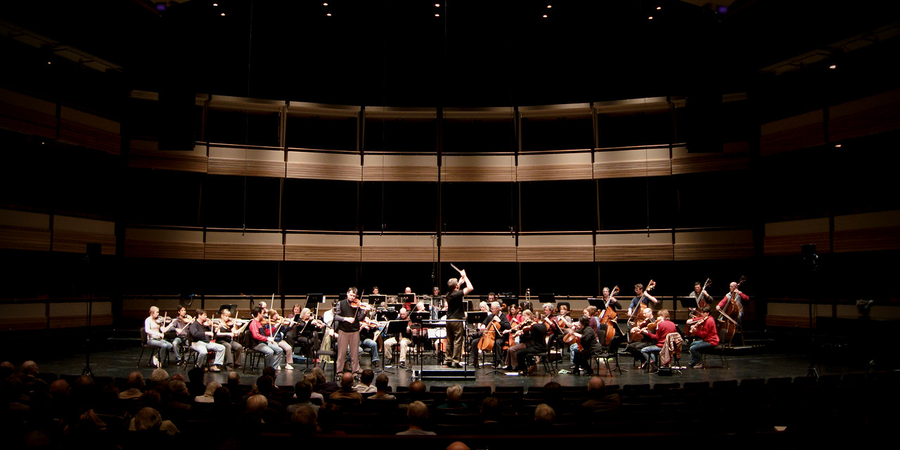 The Kitchener-Waterloo Symphony conducted by Music Director Edwin Outwater during an open dress rehearsal at the Centre in the Square.  Wide angle survey shot.
