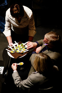"""An usher offers tasting spoons to patrons during a Kitchener-Waterloo Symphony concert entitled """"Bon Appetit""""."""