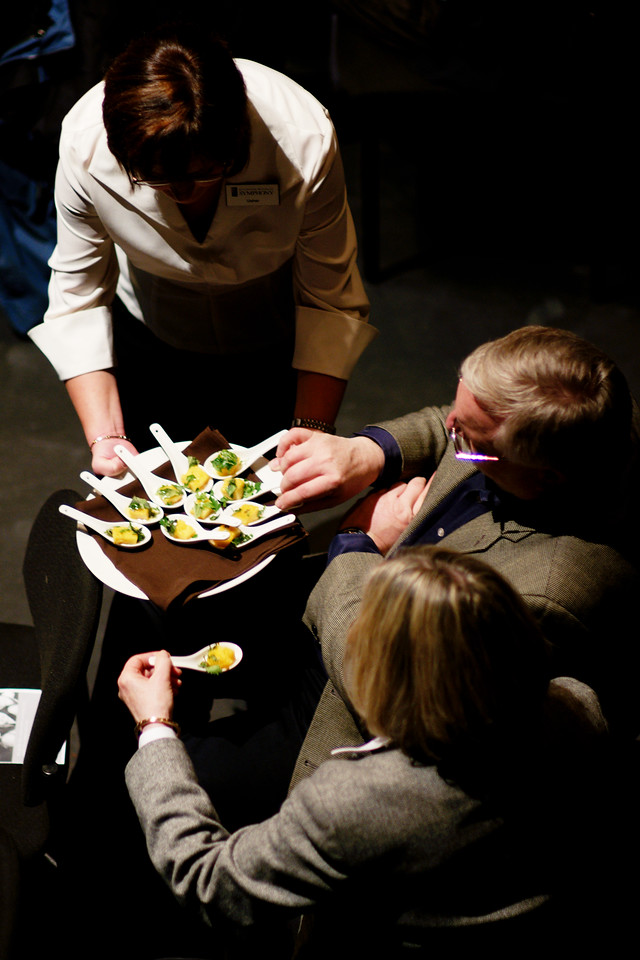 "An usher offers tasting spoons to patrons during a Kitchener-Waterloo Symphony concert entitled ""Bon Appetit""."