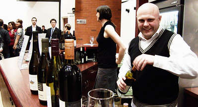 art|bar owner/sommelier Bryan ? helps out behind the bar during intermission.