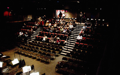 Patrons fill the seats at the Conrad Centre for the Performing Arts.