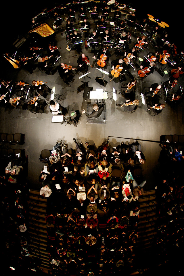 An overhead view of the Kitchener-Waterloo Symphony with guest soloist mezzo-seprano Meghan Latham led by Music Director Edwin Outwater in the Conrad Centre for the Performing Arts.