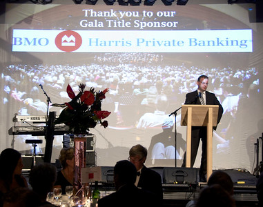BMO Harris Private Banking representative ____ speaks briefly at the dinner party.
