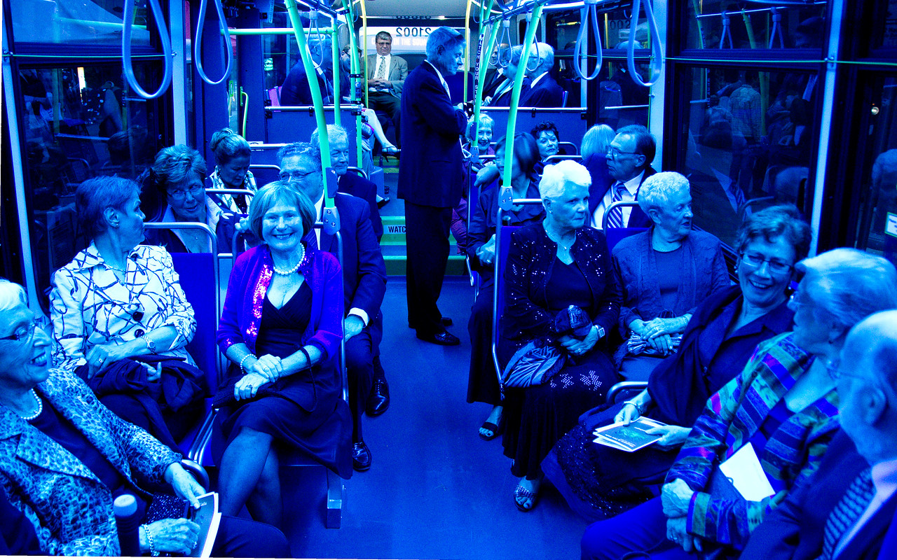 Guests ride the chartered bus to the Centre in the Square.  (Blue lights on bus.)
