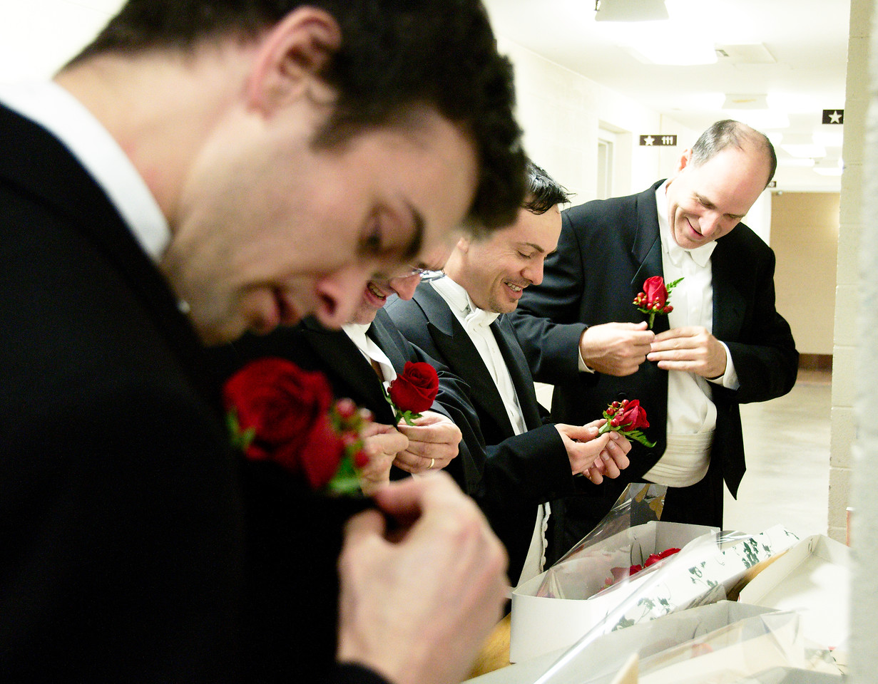 KWS musicians pin on roses before the concert.