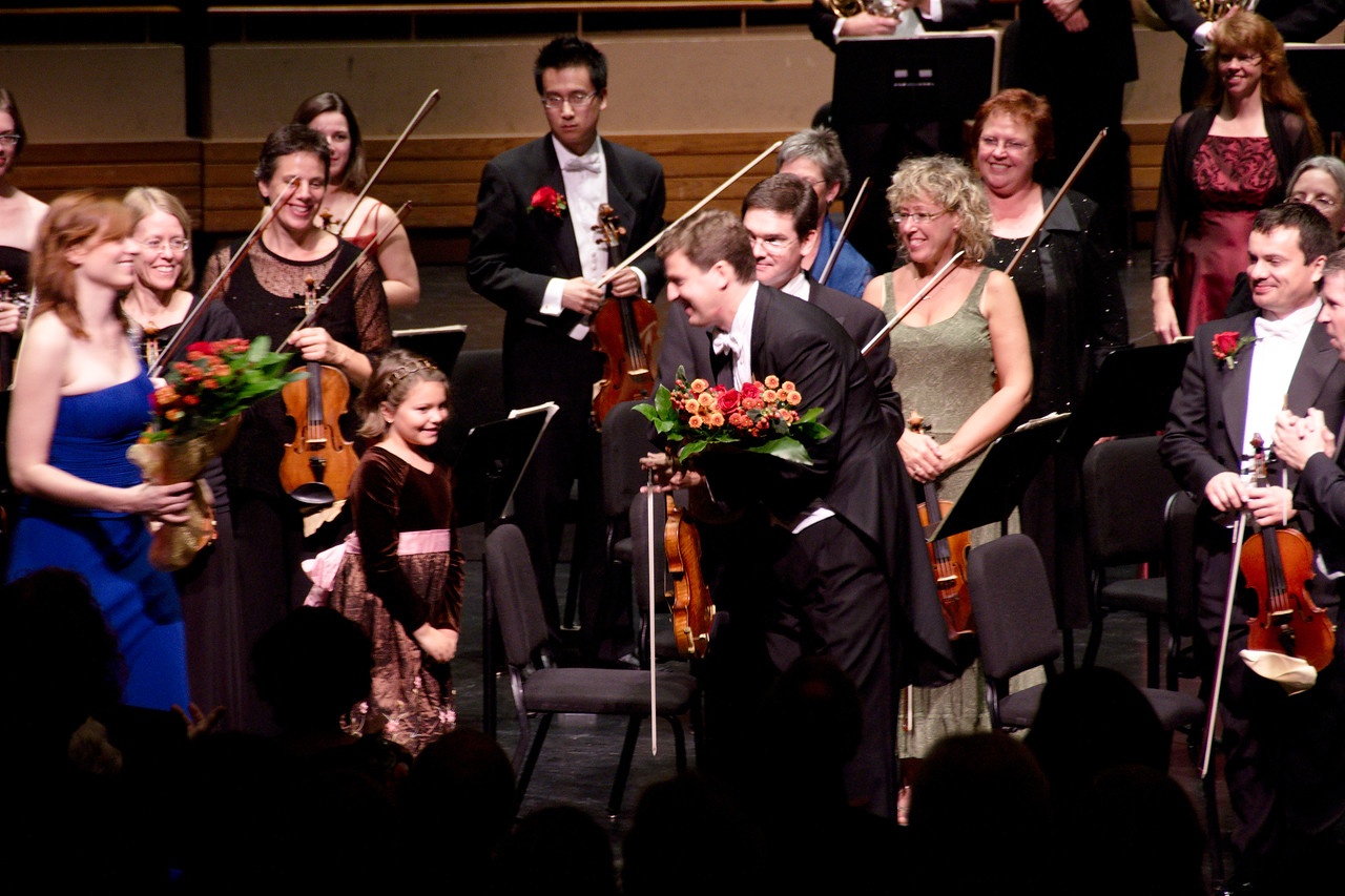 Guest soloist James Ehnes and KWS music director Edwin Outwater receive congratulatory flowers.