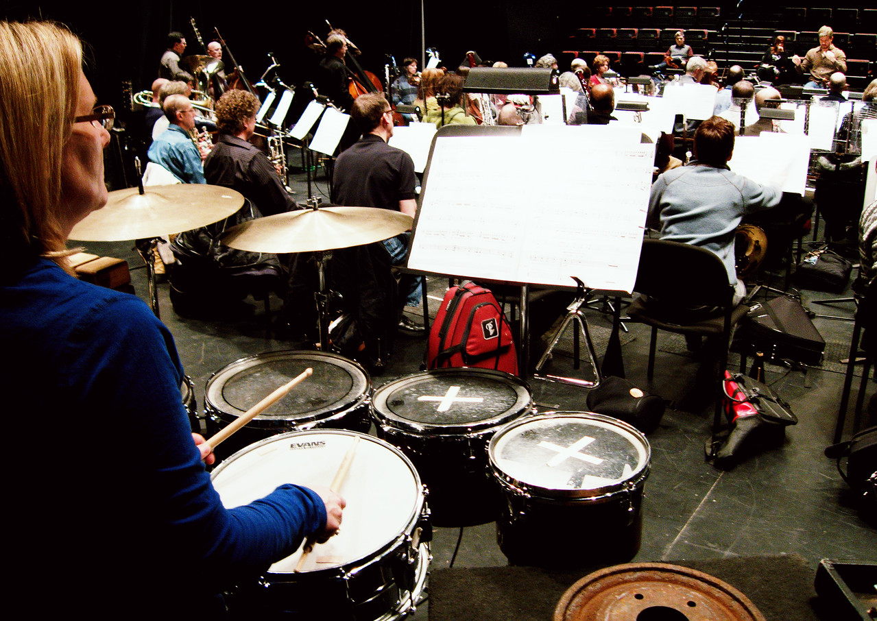 Lori West (left) and other members of the KW Symphony in rehearsal.