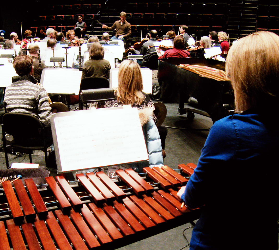Lori West (right) and additonal members of KW Symphony in rehearsal.