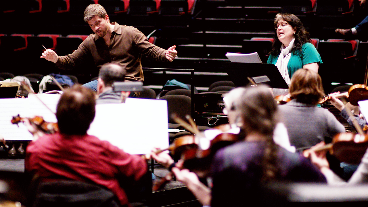 "Edwin Outwater conducts & Megan Latham sings during rehearsal for ""Bon Appetit"" concert."