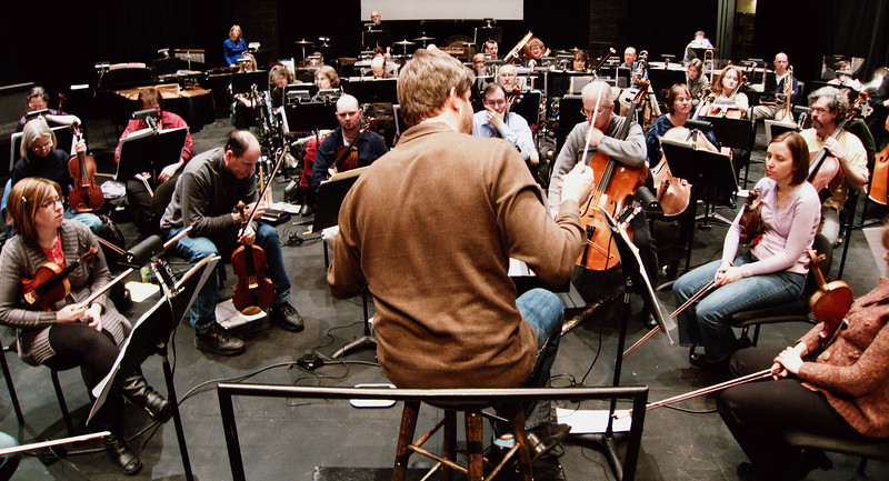 Edwin Outwater reviews performance details during rehearsals of the KW Symphony.