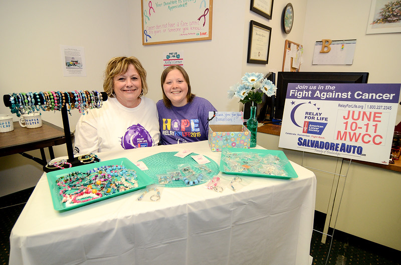 Carol Kennedy and Kelly Sidorick are currently selling jewelry and keychains at Always On Calll on Central Street in Leominster to raise money for cancer research. SENTINEL & ENTERPRISE / Ashley Green
