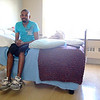 Kervens Elysee, 26, of Fitchburg talks about his accident in late February while at the Kindred Hillcrest Nursing and Rehabilitation on Summer Street in Fitchburg on Thursday afternoon. SENTINEL & ENTERPRISE/JOHN LOVE