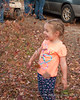 Liliana laughing and throwing leaves