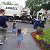 Sisters Evelyn, 3, rear, and Vivienne Culhane, 2, and their mother Meghan Culhane, of Dracut, greet Mike Lewis of Dorchester, the driver on their trash & recyling route. It was his last week in Dracut, because the town has switched to a new contractor. (SUN/Julia Malakie)