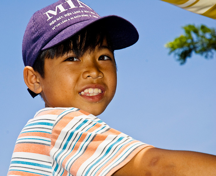 Boat driver's son, Mekong River, An Giang province, Vietnam