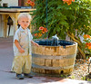 German boy at a desert oasis with trumpet vines, Joshua Tree Inn