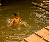 Child bathing in the Tonlé Sap, Cambodia