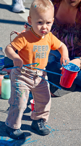 This kid looks like a handful; street fair, Naples, FL