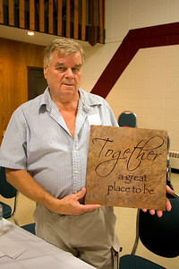 Mike Borhen holding a tile Sherie Lonsdale gave to her mother Jackie Oranchuk.  You can order them at www.wordtothewall.com
