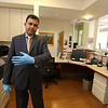 Lowell Community Health Center pediatrician Rajesh Kumble, M.D., of Andover, at the pediatrics department. This waiting area at rear will not be used. Instead, patients will be escorted up from the main lobby, and there will only be two at a time, one down one corridor, the other down the opposite corridor. They will be reopening first with infants, to get them caught up on vaccinations, and with only two patients at a time, one down each corridor.  (SUN/Julia Malakie)