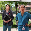 LCHC laboratory supervisor Lindsey Roberts of Amesbury, left, and chief of dental Sam Jordan of Arlington, after a session of COVID-19 testing at the tent outside Lowell Community Health Center. (SUN/Julia Malakie)
