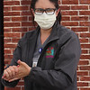 LCHC laboratory supervisor Lindsey Roberts of Amesbury disinfects her hands after taking off her gloves after a session of COVID-19 testing at the tent outside Lowell Community Health Center. (SUN/Julia Malakie)