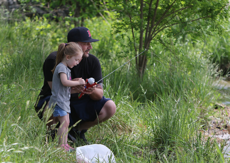 Bobby Desrosiers fishes with his daughter Brinley, 3, at  Lake Mascuppic in Tyngsboro. (SUN/Julia Malakie) [forgot to get town]