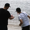 Bobby Desrosiers fishes with his son Nathan Desrosiers, 14, at  Lake Mascuppic in Tyngsboro. (SUN/Julia Malakie)  [forgot to get town]
