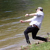 Jason Pagan of Revere tries skipping stones at  Lake Mascuppic in Tyngsboro. He's a grad student at UMass Lowell and is househunting in the area. (SUN/Julia Malakie)