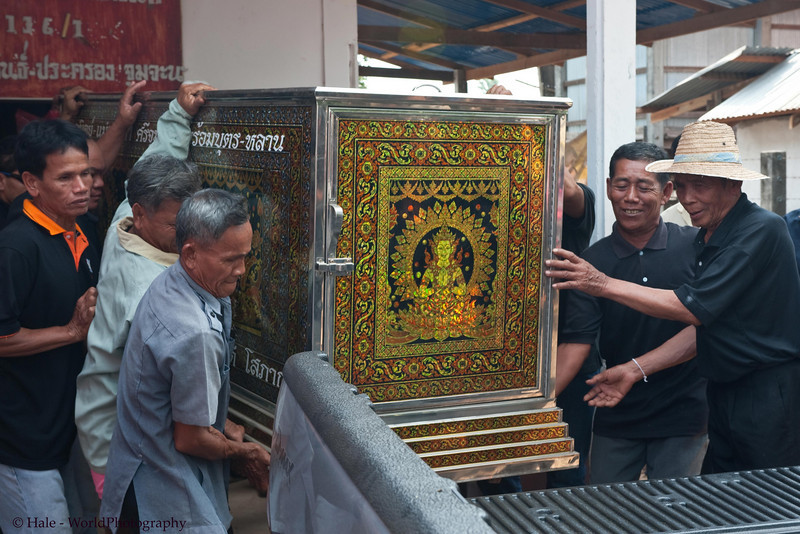 Family Members Loading Rented Refrigerated Container and Coffin for Procession to Local Wat