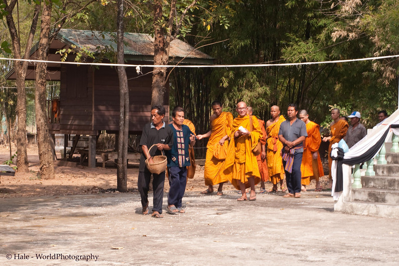 Monks Lead Funeral Procession Around the Crematorium as Man Scatters Puffed Rice As Offerings to the Spirits