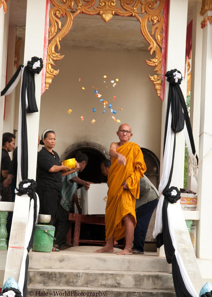 Buddhist Abbot Tossing Candies and Foil Wrapped Coins to the Funeral Participants