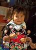Young Hmong Girl Eating An Orange, Luang Prabang Laos