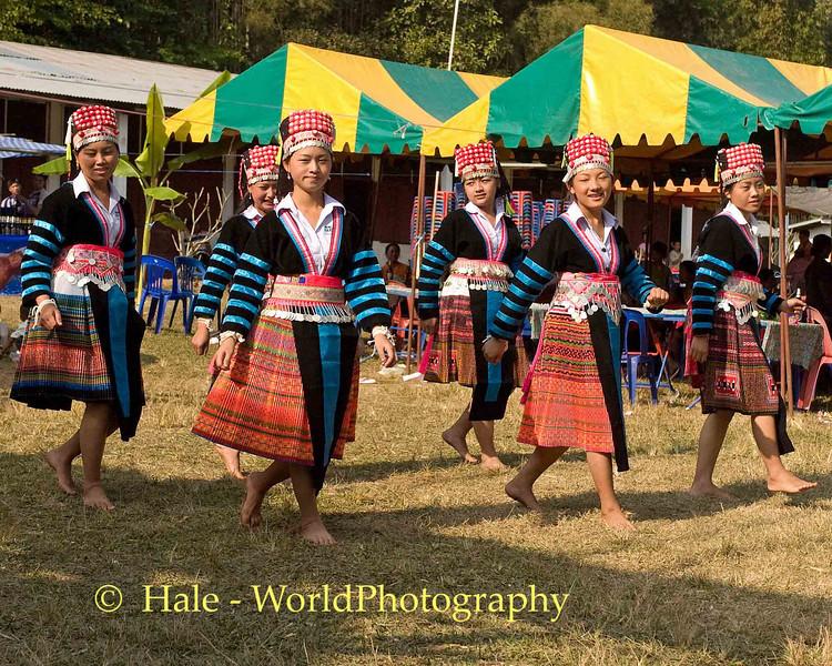Hmong Women dancing at New Year Festival, Luang Prabang, Laos