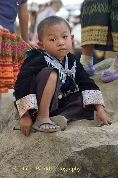 Hmong Boy On A Rock, New Year Festival in Luang Prabang, Laos