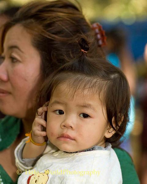 Mother and Daughter at Hmong New Year Festival, Luang Prabang, Laos