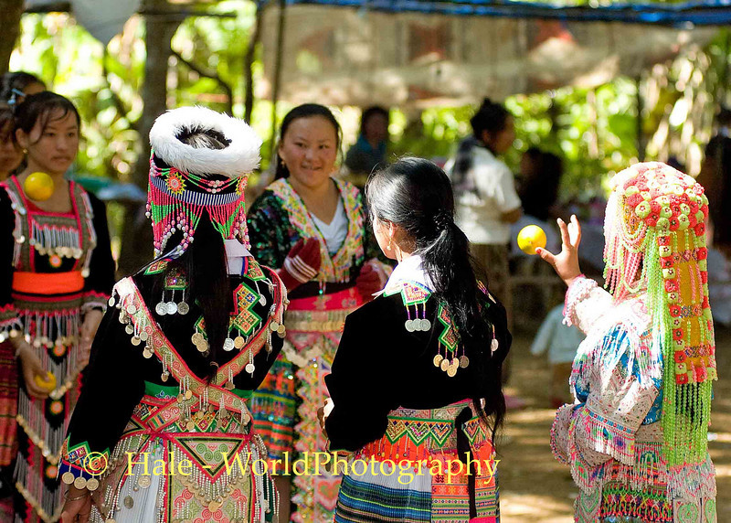 Hmong Women Playing Pov Pob at New Year Festival, Luang Prabang, Laos