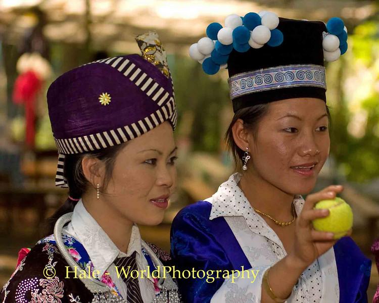 Two Young Hmong Women Playing Pov Pob, Luang Praban, Laos