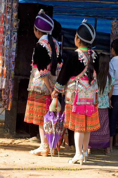 Hmong Girls Checking Out the Latest CDs, New Year Festival in Luang Prabang, Laos