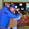 Larry Larochelle (right), a veteran from Winchendon, now living at the Beacon Hospice in Fitchburg, hugs his friend Armand Dube of Winchendon at the Montachusett Veterans Outreach Center in Winchendon for a reception after he received a tour of his hometown in a limo from St. Germain Auto Sales from Fitchburg, Thursday.<br /> SENTINEL & ENTERPRISE / BRETT CRAWFORD
