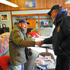 Larry Larochelle (left), a veteran from Winchendon, now living at the Beacon Hospice in Fitchburg, shakes hands with his friend Fran Murphy after seeing him for the first time in 20 years at the Montachusett Veterans Outreach Center in Winchendon for reception after he received a tour of his hometown in a limo from St. Germain Auto Sales from Fitchburg, Thursday.<br /> SENTINEL & ENTERPRISE / BRETT CRAWFORD