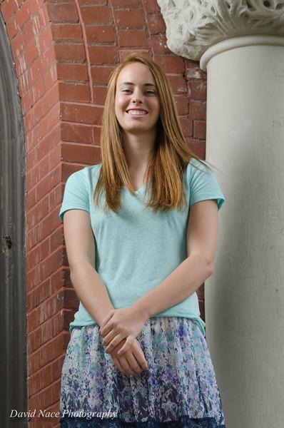 Lauren by front entrance columns-85